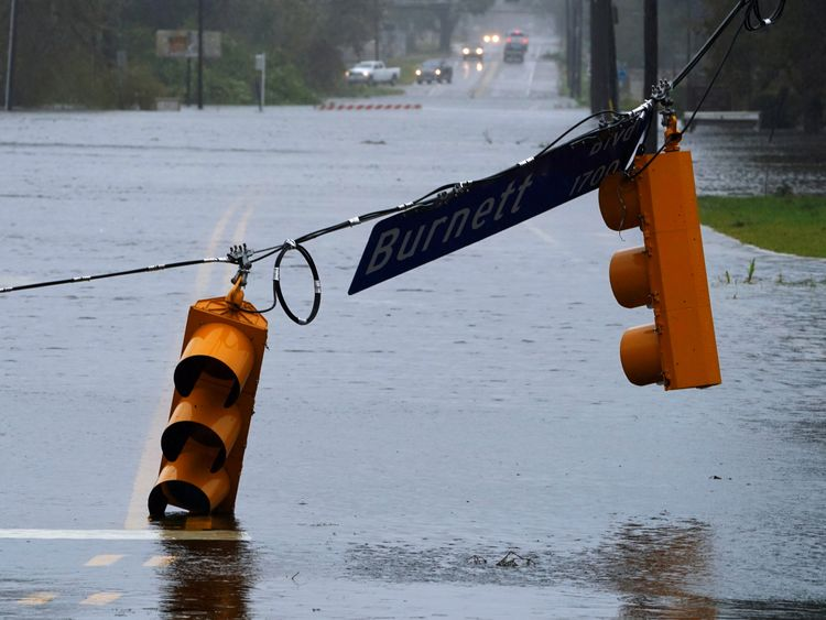 A street light is downed on a flooded road as Hurricane Florence comes ashore on Wilmington