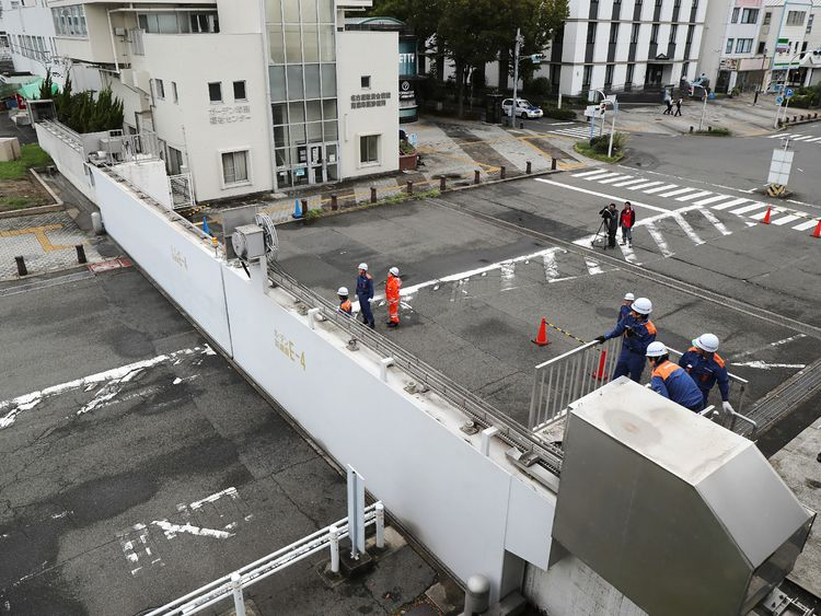 Nagoya port officers close the breakwater gates in Nagoya as Typhoon Jebi hit western Japan