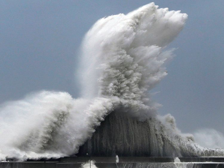 High waves hit breakwaters at a port of Aki, Kochi prefecture, Japan