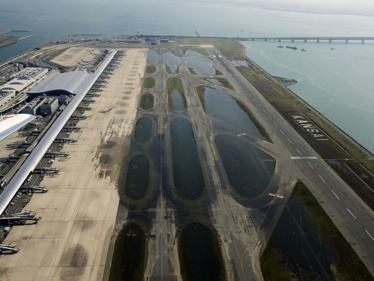 An aerial view shows a flooded runway at Kansai airport, which is built on a man-made island in a bay, after Typhoon Jebi hit the area