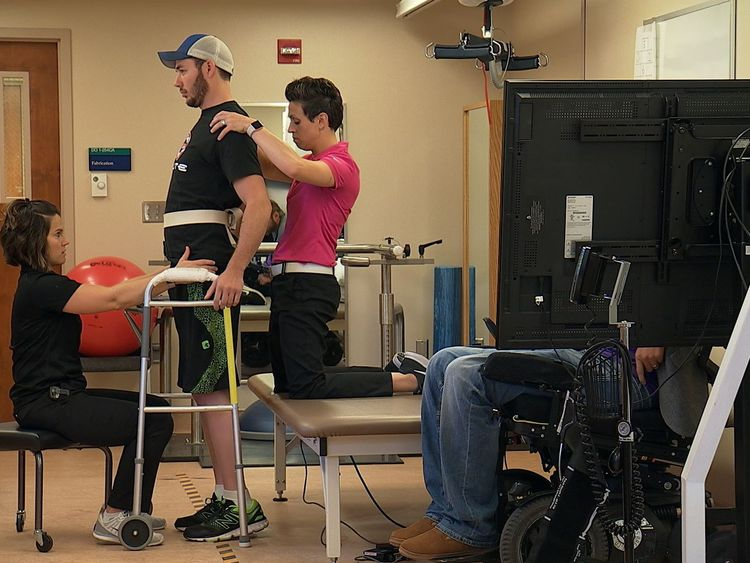 Spinal implant helps paralysed man walk again