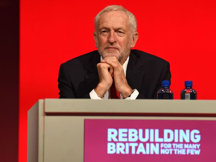 Labour leader Jeremy Corbyn listens to a speech at the party conference in Liverpool