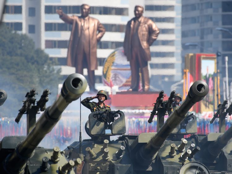 Korean People's Army (KPA) soldiers salute as they ride tanks during a military parade and mass rally on Kim Il Sung square in Pyongyang on September 9, 2018