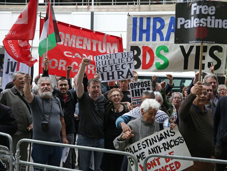 Some Corbyn supporters held signs calling for the NEC to not be 'bullied' the IHRA
