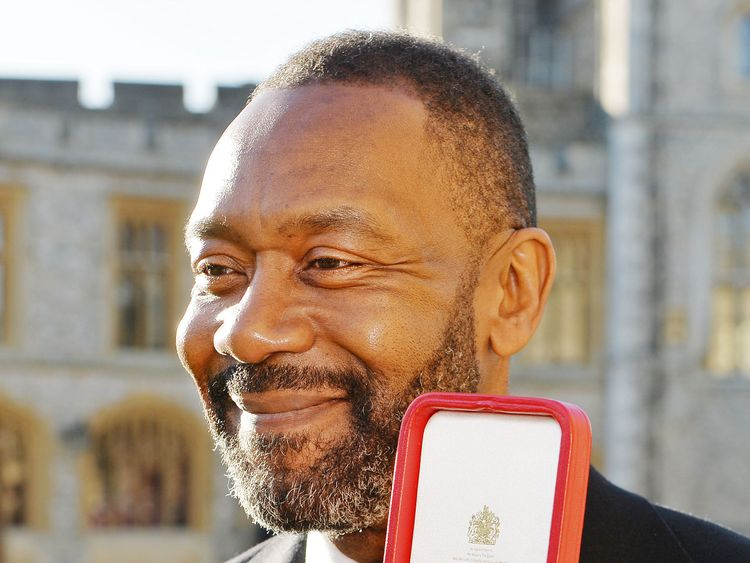 British actor Lenny Henry with his Knighthood after he was presented with it by Britain's Queen Elizabeth during an Investiture ceremony at Windsor Castle in Windsor, west of London on December 4, 2015
