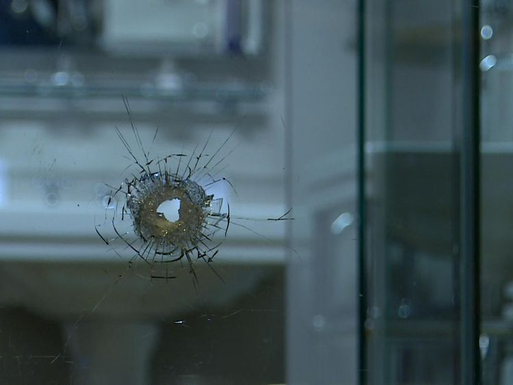 A bathroom window suffered apparent bullet damage