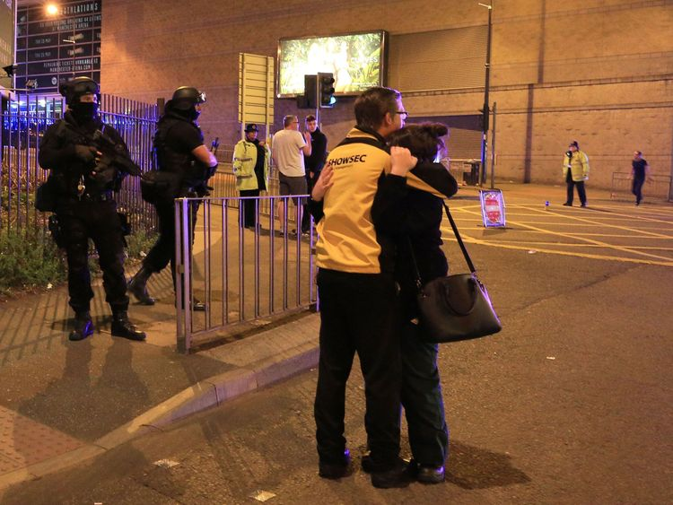Two people hug after the Manchester Arena attack