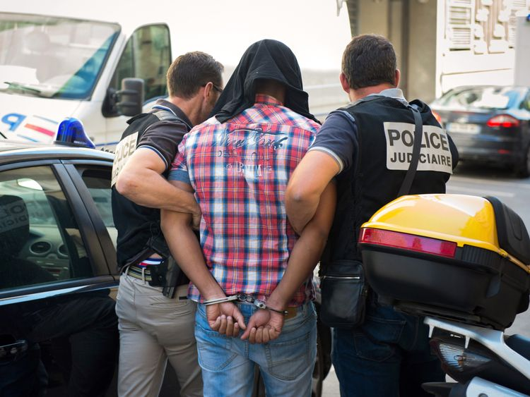 One of the alleged suspects over the death of Ms Pastor arrives at a Marseille courthouse in 2014