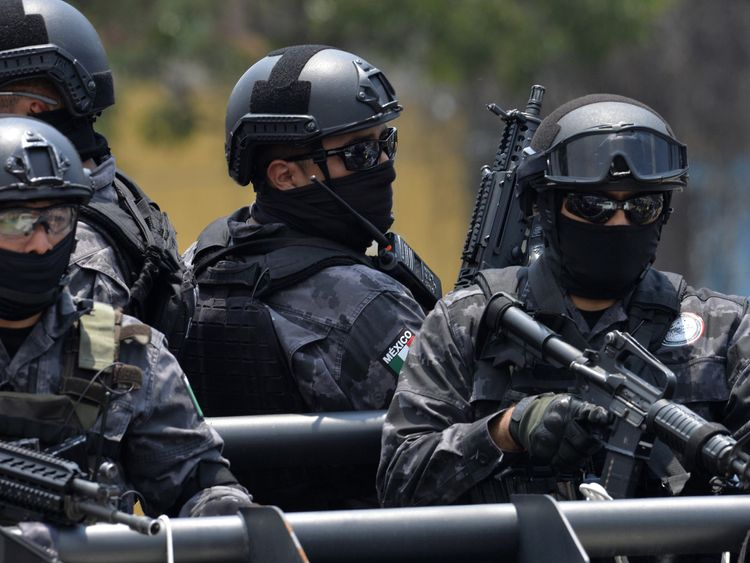 Police stand guard as a heavily guarded convoy transports former governor of Veracruz Javier Duarte on July 17, 2017 upon his arrival in Mexico City, on July 17, 2017