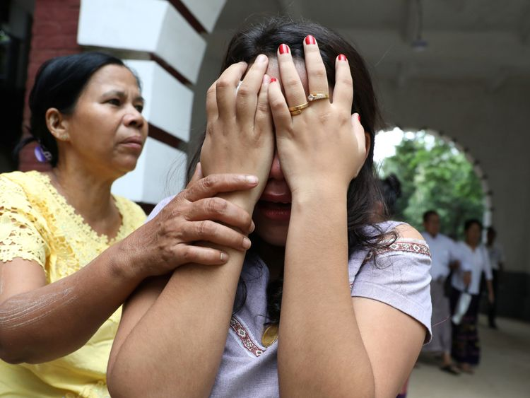 Relatives of Reuters journalist Kyaw Soe Oo leave after listening to the verdict