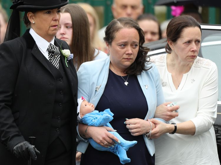 Tracey Taundry (middle), the eight-year-old's mother, at her funeral