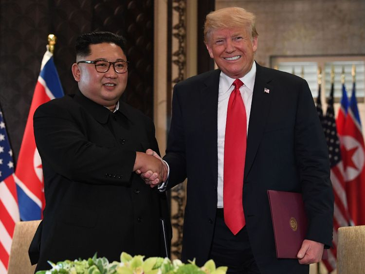 North Korean leader Kim Jong Un shakes hands with US President Donald Trump during a historic summit of the two nations