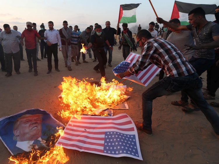 Palestinians burned the US flag and Trump pictures after the US Embassy moved to Jerusalem