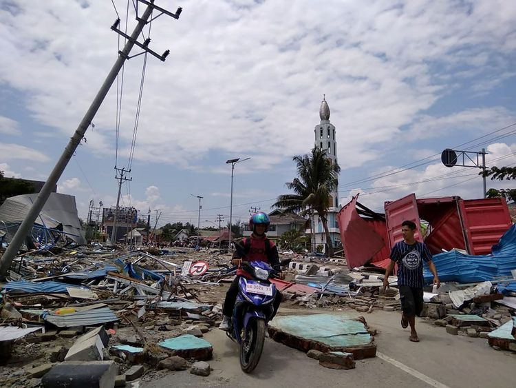A street full of debris after an earthquake and tsunami hit Palu, on Sulawesi island