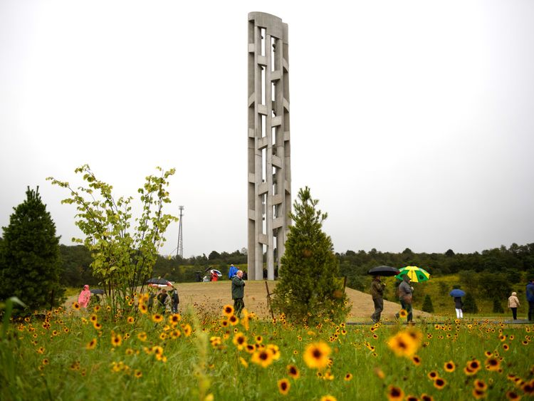 SHANKSVILLE, PA - SEPTEMBER 09: The Tower of Voices stands above visitors, dignitaries and family members of the victims of Flight 93 at the Flight 93 National Memorial on September 9, 2018 in Shanksville, Pennsylvania. (Photo by Jeff Swensen/Getty Images)