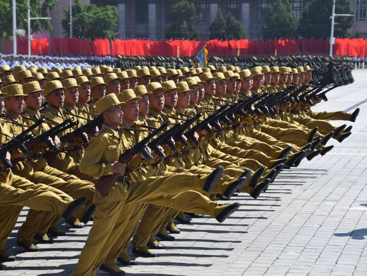 Military personnel march during the parade in Pyongyang