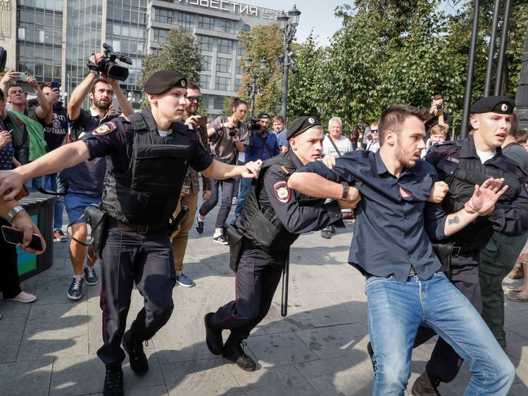Officers arrested dozens of protesters in Moscow