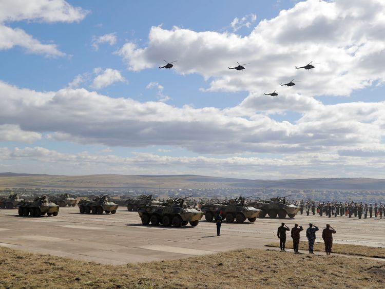 "Military vehicles and helicopters in motion during a parade on training ground ""Telemba"""