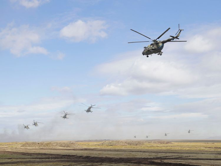 "Military helicopters fly over the training ground ""Tsugol"""