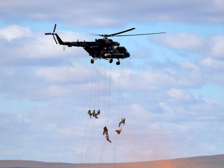 "Soldiers abseil from a military helicopter over the training ground ""Tsugol"""