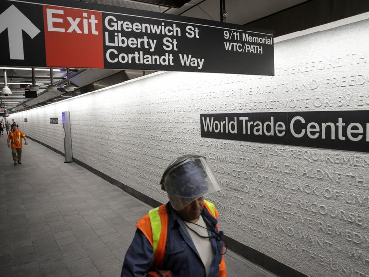 NEW YORK, NY - SEPTEMBER 10: Workers walk along the platform at the newly opened Cortland Street 1 train station September 10, 2018 in New York City. The Cortland Street 1 train station was buried in debris following the 9/11 terrorist attacks and had been closed since that day 17 years ago. The newly renovated version of the station opened on Saturday. (Photo by Drew Angerer/Getty Images)