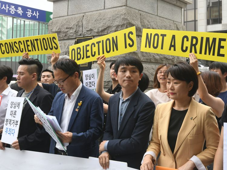 South Korean activists and conscientious objectors to military service during a rally outside the Constitutional Court in Seoul