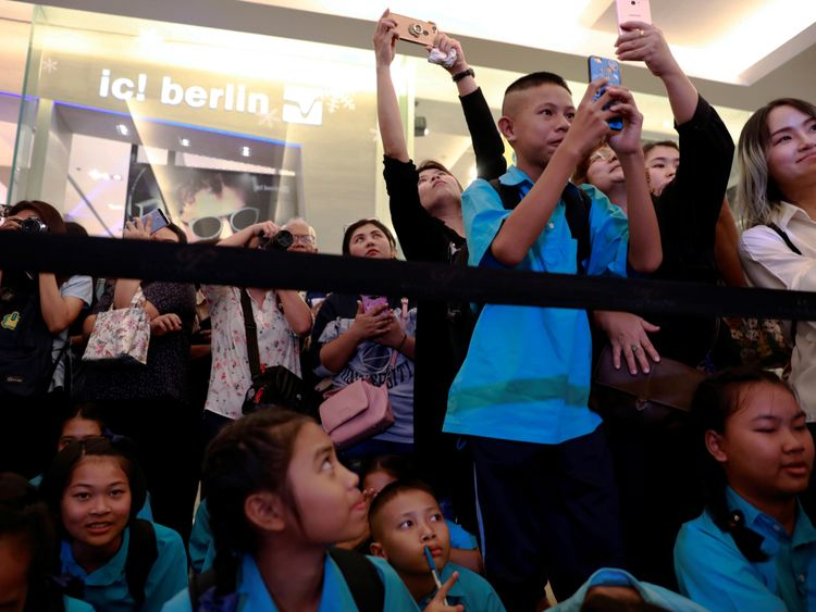 "Crowds as the ""Wild Boars"" soccer team visit an exhibition featuring their cave rescue earlier this year, in Bangkok, Thailand"