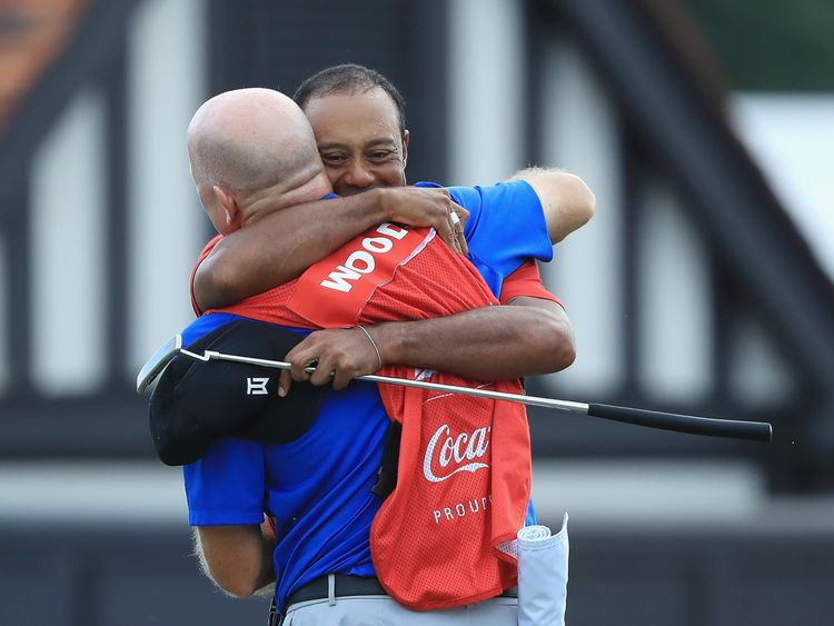 Woods celebrates with caddie Joe LaCava
