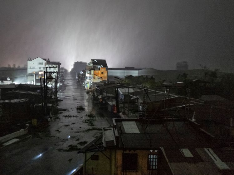 Rains cover the city as strong winds batter houses and buildings lying on the path of Typhoon Mangkhut as it makes landfall on September 15, 2018 in Tuguegarao city, northern Philippines