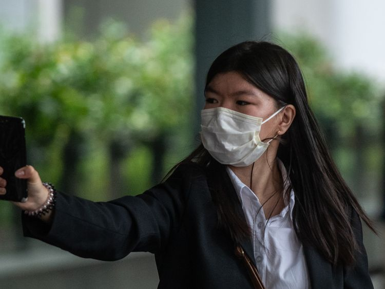 Khaw May-ling, the eldest daughter of the accused, leaves court after testifying