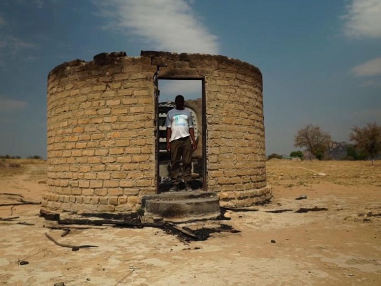 David stands in the ruins of his home