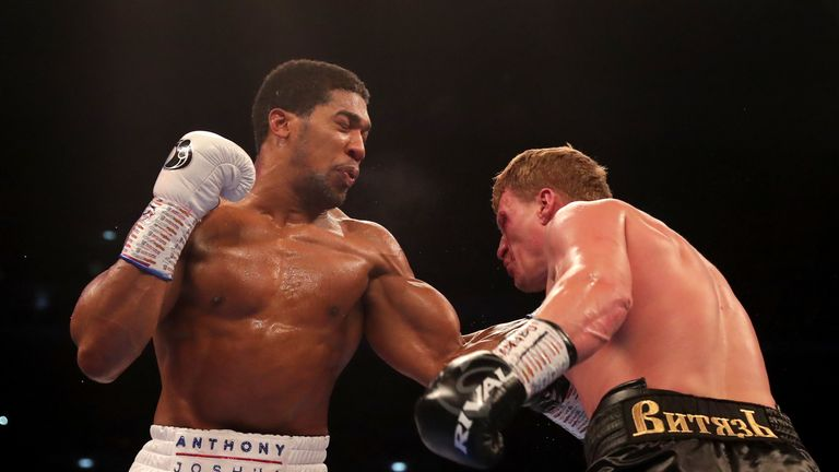 Anthony Joshua throws a left hook