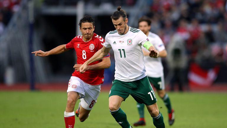Gareth Bale runs at the Denmark defence