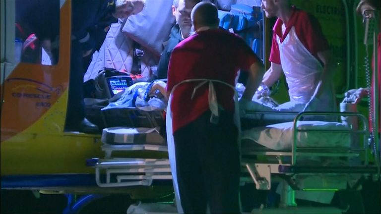 Pic: Screengrab from Associated Press video Justine Barwick, from Tasmania, was bitten on the leg by a shark while swimming at Cid Harbour in Australia's Whitsunday Islands and flown to Mackay Base Hospital on 19 September 2018.