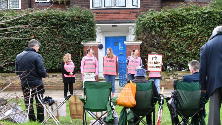 Pro-choice demonstrators (back) and pro-life demonstrators (foreground) outside the Marie Stopes clinic in Ealing