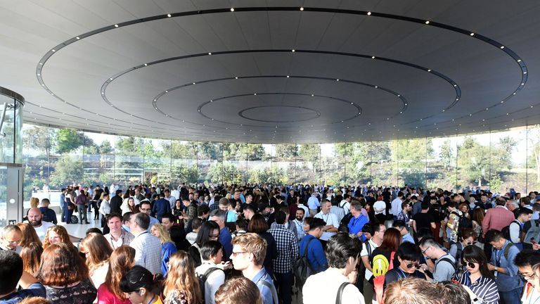 A crowd of people wait to enter the Steve Jobs Theater ahead of a media event where Apple is expected to announce a new iPhone and other products in Cupertino, California on September 12, 2017. / AFP PHOTO / Josh Edelson (Photo credit should read JOSH EDELSON/AFP/Getty Images)