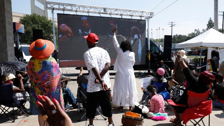 Fans watched the service on a screen