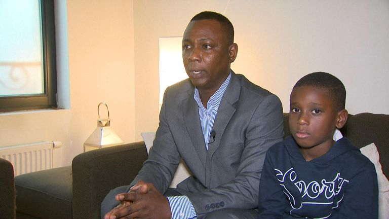 Mohamed Bangoura (pictured with family friend Laurent Diallo) is stranded in Belgium because the Home Office revoked his passport