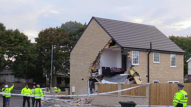 The collision has torn off a corner of a house on the street in Barnsley