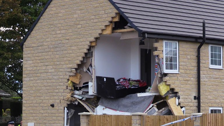 A bedroom in the house has been fully exposed by the collision
