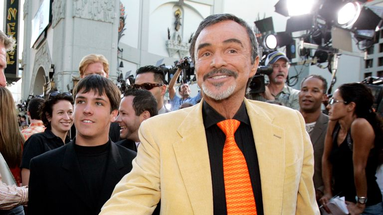 Actor Burt Reynolds (C), followed by his son Quinton (L), arrives at the Los Angeles premiere of the Warner Brothers pictures The Dukes Of Hazzard at the Grauman's Chinese theatre in Hollywood July 28, 2005