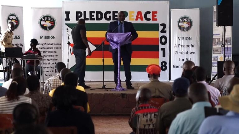 Charles Masunungure, commissioner of Zimbabwe's Peace and Reconciliation Commission, addresses voters