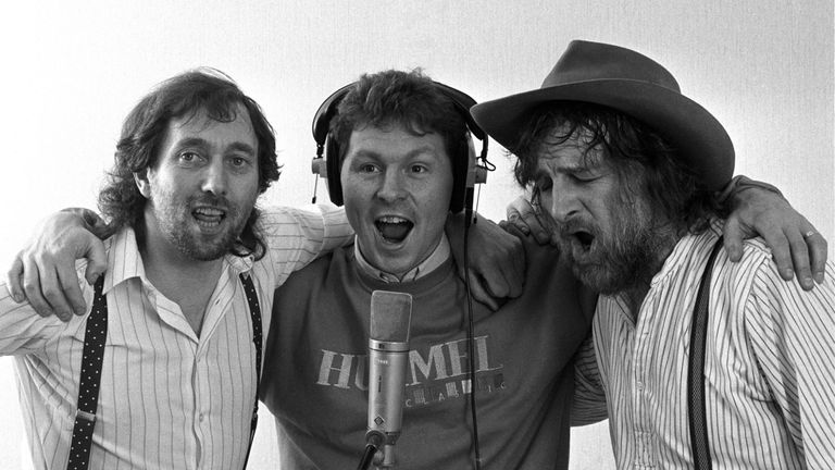 "Spur's Clive Allen (centre) gets vocal support in 1987 from Spur's fan Chas (right) and Dave during the recording of the team's new single ""Hot Shot Tottenham"""