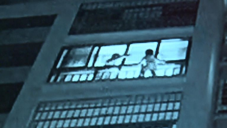 Boy rescued after being stuck outside window of building in China