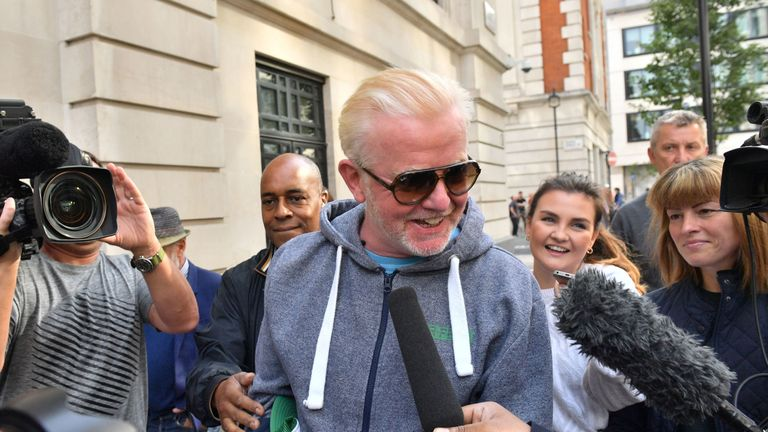 Chris Evans surrounded by media as he leaves the Radio 2 studio in London