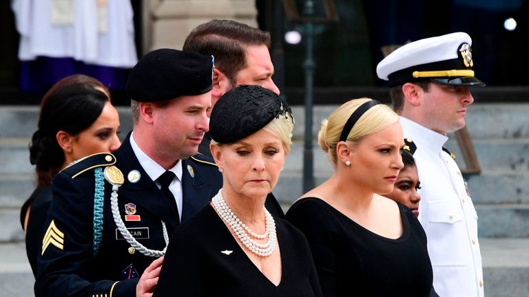 Cindy McCain (C) the widow of US Senator John McCain and her sons and daughters look on after a Military Honor Guard placed the casket of US Senator John McCain into a hearse at the end of his memorial service for at the Washington National Cathedral in Washington, DC, on September 1, 2018. (Photo by JIM WATSON / AFP) (Photo credit should read JIM WATSON/AFP/Getty Images)