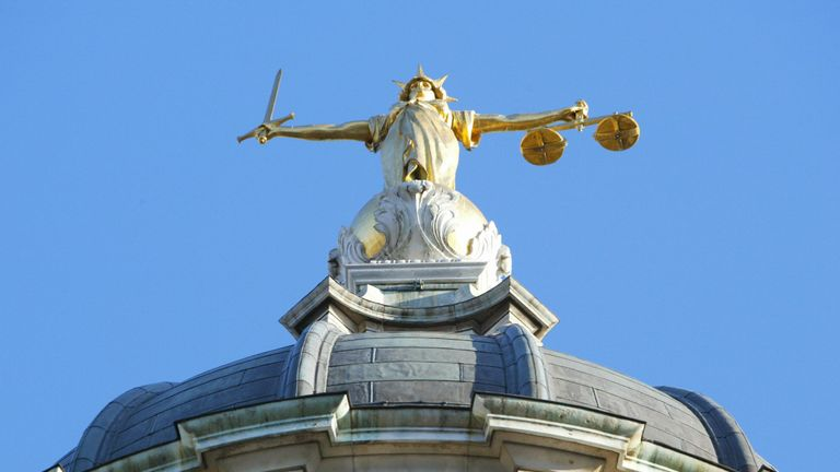 LONDON, UNITED KINGDOM: The statue of justice stands on the copula of the Old Bailey courthouse after Ian Huntley was sentenced to two life terms in prison for murdering 10-year-old school girls Holly Wells and Jessica Chapman and his girl friend Maxine Wells was convicted of preverting the course of justice 17 December, 2003 in London. AFP PHOTO/ADRIAN DENNIS (Photo credit should read ADRIAN DENNIS/AFP/Getty Images)