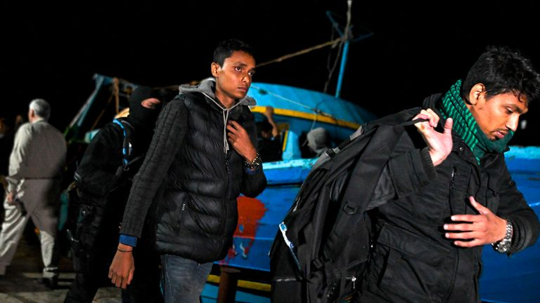 Migrants rescued from their boat in May off the coast of Crete