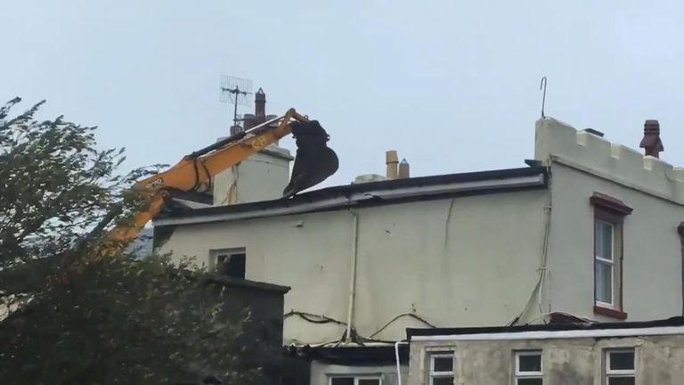Digger holds down roof in Ireland