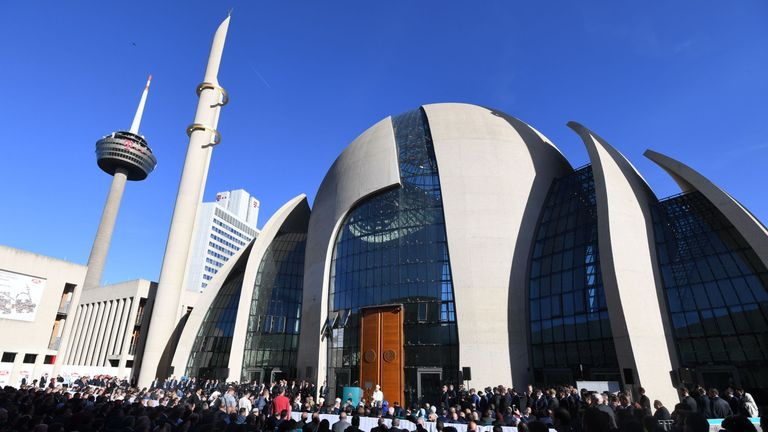 Visitors gather in front of the newly built DITIB central mosque in Cologne, western Germany, prior to its official opening on September 29, 2018